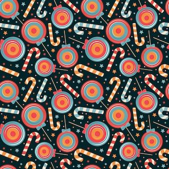 Modèle sans couture de canne à sucre de noël, bonbons de vacances, sucette sur fond sombre. joyeux noël et bonne année illustration. conception pour enfants textile, tissu, papier d'emballage