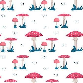 Modèle sans couture avec des champignons amanita avec un chapeau rose vif et des points blancs et de l'herbe sur un bac blanc...