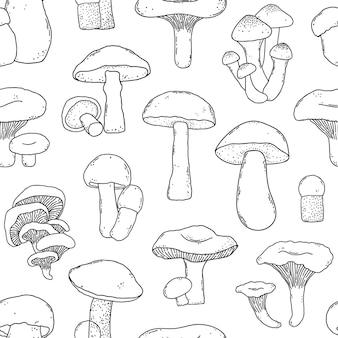 Modèle sans couture avec champignons dessinés à la main dans un style doodle sur fond blanc.