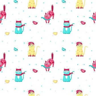 Modèle sans couture avec des chats d'hiver mignon