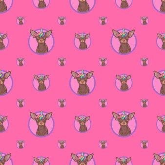 Modèle sans couture avec un chien licorne mignon sur fond rose pour l'emballage de papier d'emballage