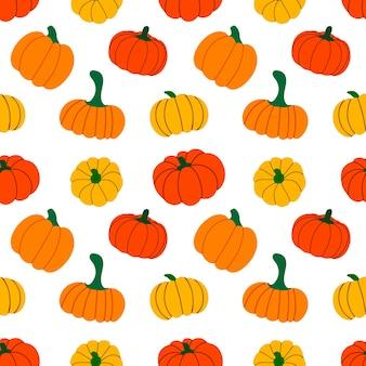 Modèle sans couture avec des citrouilles d'automne de couleur orange
