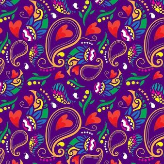 Modèle sans couture de coeurs rouges paisley coloré