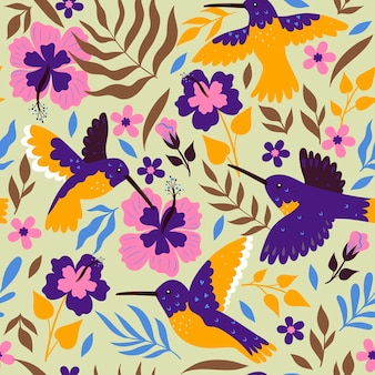 Modèle sans couture avec colibris et hibiscus. graphiques vectoriels.