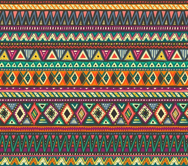Modèle sans couture coloré avec des éléments ethniques dessinés à la main