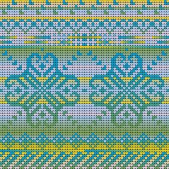 Modèle sans couture de couleurs dégradées d'un pull laid de noël avec fleur d'hiver
