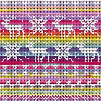 Modèle sans couture de couleurs néon arc-en-ciel avec des cerfs et des étoiles tricotés
