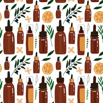 Modèle sans couture dans un style plat avec emballage cosmétique et élément végétal - orange, branches d'olivier