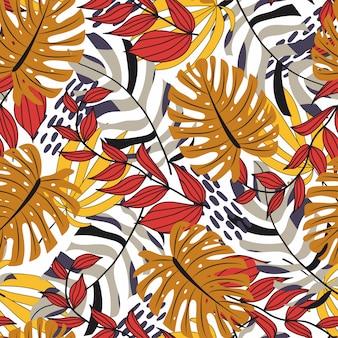 Modèle sans couture dans un style tropical avec des plantes colorées et des feuilles rouges et jaunes