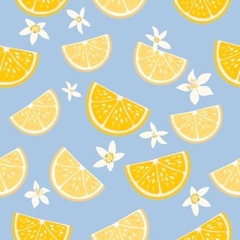 Modèle sans couture décoratif avec des citrons et des fleurs