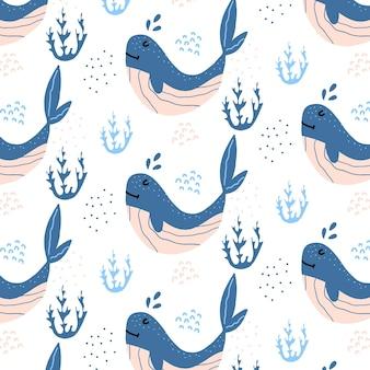 Modèle sans couture dessiné à la main enfantin avec des baleines bleues