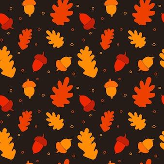 Modèle sans couture dessiné à la main de glands d'automne