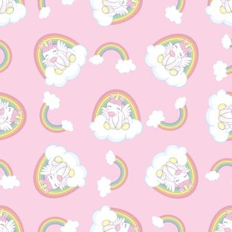 Modèle sans couture dessiné main avec licorne, nuages et arc-en-ciel