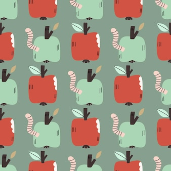 Modèle sans couture dessiné à la main avec des pommes et des vers. adorable arrière-plan répété pour le textile, le papier peint, le scrapbooking, les tissus et les imprimés.