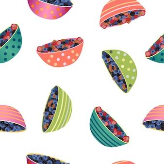 Modèle sans couture dessinés à la main avec des bols de baies.