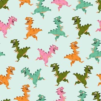Modèle sans couture de dinosaures colorés sur bleu