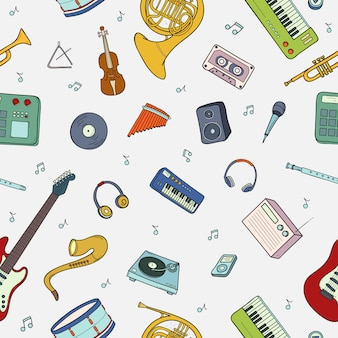 Modèle sans couture avec divers instruments de musique, symboles, objets et éléments.