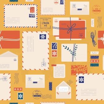 Modèle sans couture d'enveloppe de noël. enveloppe de courrier, autocollants, timbres et carte postale