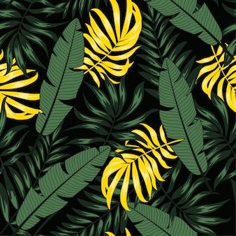 Modèle sans couture d'été avec des feuilles tropicales jaunes et vertes