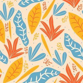 Modèle sans couture avec des feuilles bleues, orange et jaunes