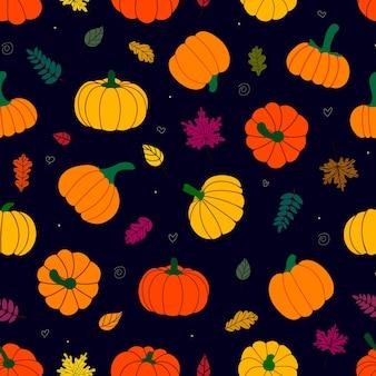 Modèle sans couture de feuilles fanées multicolores et de citrouilles mûres sur fond sombre