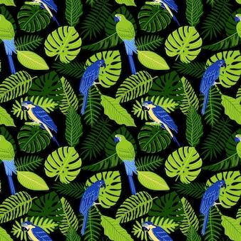 Modèle sans couture avec des feuilles de monstera tropicales et des perroquets bleus et or et ara jacinthe