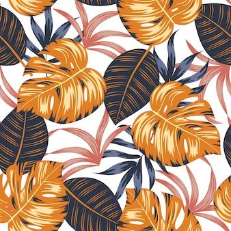 Modèle sans couture avec des feuilles et des plantes tropicales