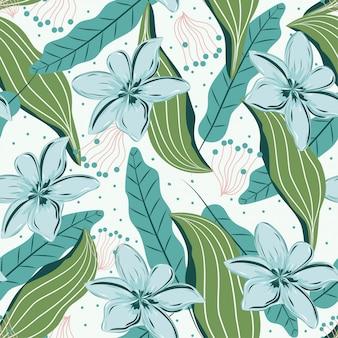 Modèle sans couture avec des feuilles tropicales et des fleurs délicates