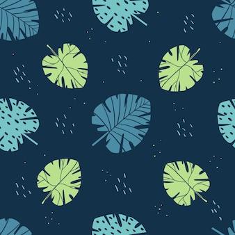 Modèle sans couture avec des feuilles tropicales. sur un fond sombre.