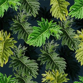 Modèle sans couture de feuilles tropicales.