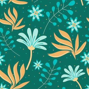 Modèle sans couture avec des fleurs et des feuilles