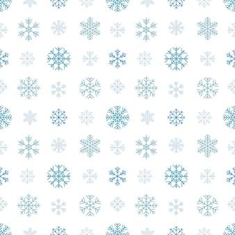 Modèle sans couture avec des flocons de neige bleus