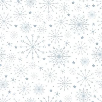 Modèle sans couture avec des flocons de neige mignons de différentes tailles