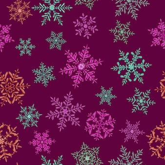 Modèle sans couture de flocons de neige de noël complexes en différentes couleurs sur fond violet