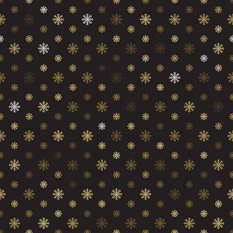 Modèle sans couture de flocons de neige d'or sur fond noir.