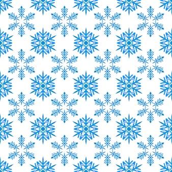 Modèle sans couture de flocons de neige de style plat