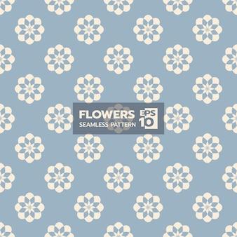 Modèle sans couture de forme florale contemporaine sur bleu clair
