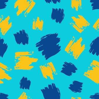 Modèle sans couture avec frottis de gribouillis dessinés à la main jaune et bleu sur fond bleu. texture grunge abstraite. illustration vectorielle