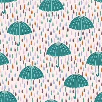 Modèle sans couture avec des gouttes de pluie et des parapluies.