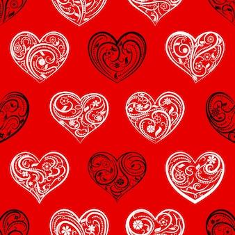 Modèle sans couture de grands coeurs avec ornement de boucles, de fleurs et de feuilles, blanc et noir sur rouge