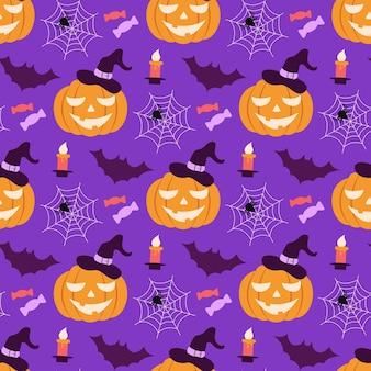 Modèle sans couture d'halloween avec une citrouille dans un chapeau et des chauves-souris et des bonbons de toiles d'araignée
