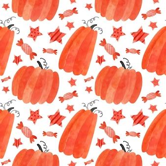 Modèle sans couture d'halloween avec des citrouilles rouges et des bonbons papier de scrapbooking numérique spooky