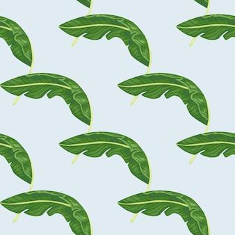 Modèle sans couture hawaii dessiné à la main avec une simple impression de feuille de bananier vert. fond pastel clair.