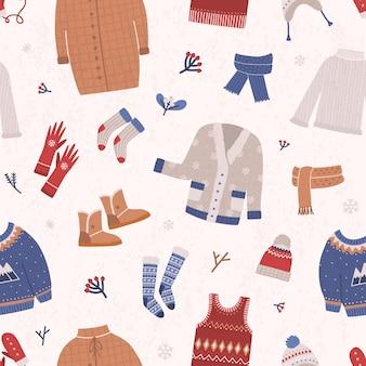 Modèle sans couture d'hiver avec des vêtements tricotés chauds sur la lumière