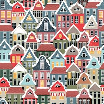 Modèle sans couture d'hiver avec de vieilles maisons.