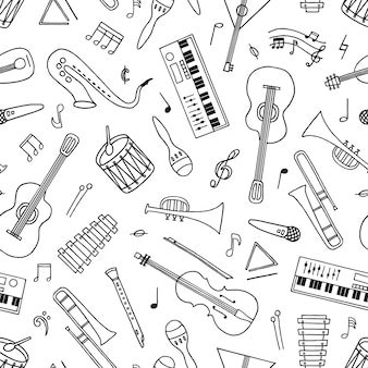 Modèle sans couture d'instruments de musique dessinés à la main dans un style doodle sur blanc