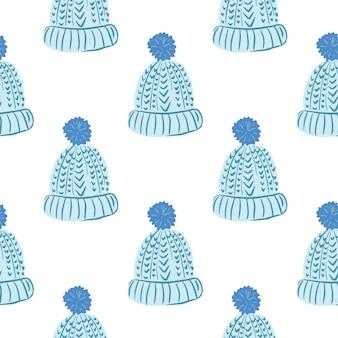 Modèle sans couture isolé avec chapeau confortable doodle bleu