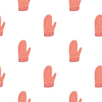 Modèle sans couture isolé de mitaines de dessin animé simple rose. hiver douillet
