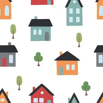 Modèle sans couture de jolies maisons et arbres dessinés à la main dans un style plat