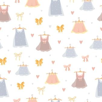 Modèle Sans Couture De Jolies Robes Pastel Vecteur gratuit